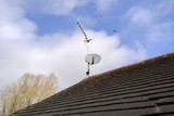 A satellite dish and TV arial