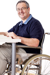 Man sitting in a wheelchair at the table