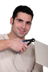 Man using pincers
