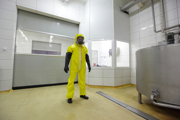 professional in protective uniform  in industrial environment