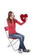 Frau mit Herz telefoniert - woman with heart on the phone