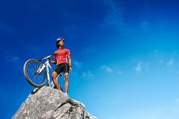 confident mountain bike man celebrating