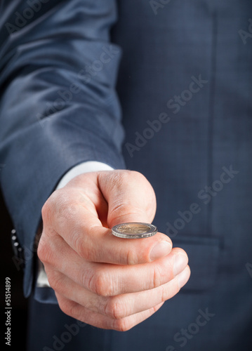 Businesman tossing a coin
