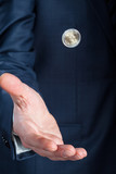 Businessman flipping a coin
