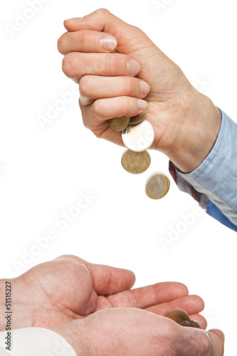 Pouring coins into hands on white backhround