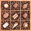 Assorted chocolates in wooden box with coffee beans