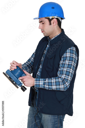 Man about to use electric sander