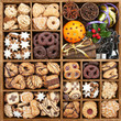 Assorted Christmas cookies in wooden box with baking items
