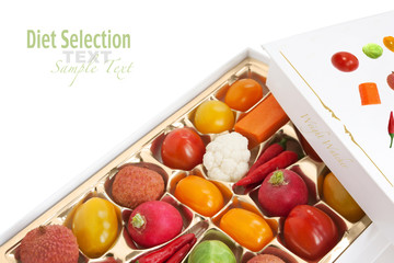 Chocolate box with vegetable and fruit contents - concept