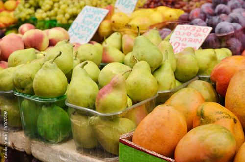 close up of pears on market stand