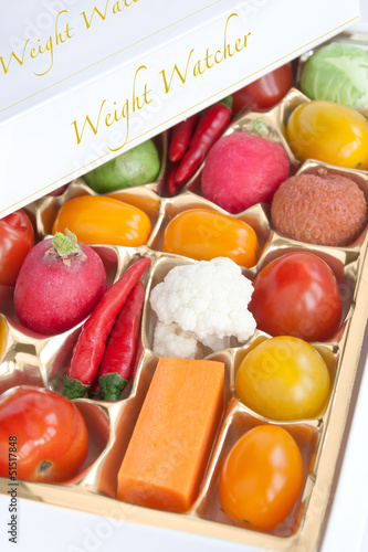 Chocolate box with vegetable and fruits - humorous concept