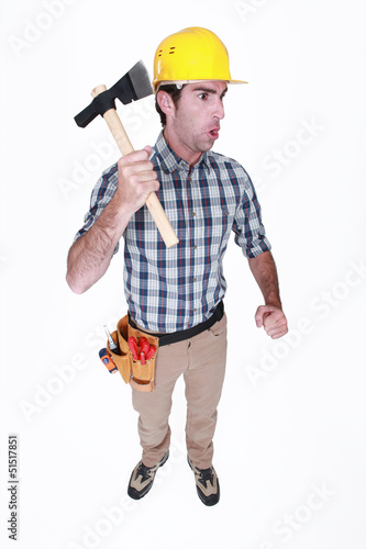 Angry worker holding axe