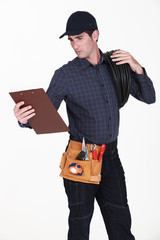 Electrician with a clipboard