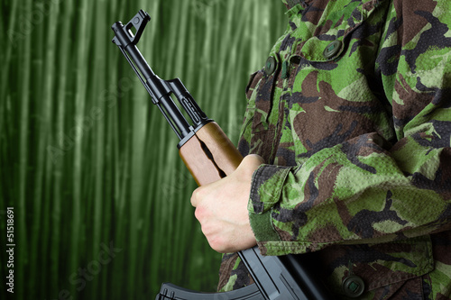 Soldier holding rifle AK-47