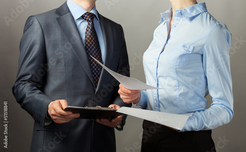 Businessman and businesswoman discuss a plan of work