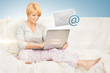 woman with laptop computer sending e-mail