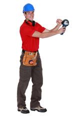 Man holding angle grinder