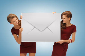 girls holding big envelope