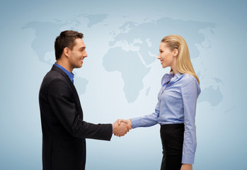 woman and man shaking hands