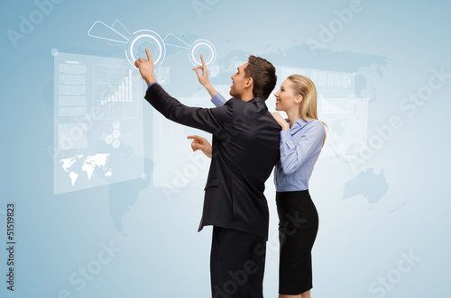 man and woman working with virtual screen