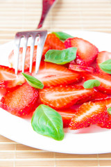Traditional dessert strawberry with basil