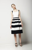 Elegant Woman Fashion Model in Light Striped Cotton Sundress