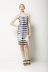 Clothes Collection. Woman in Light Dress with Streaks. Fashion
