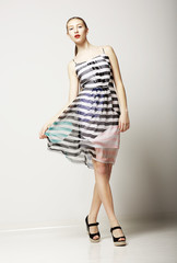 Slim Female wearing Sleeveless Tabby Dress. Sensuality