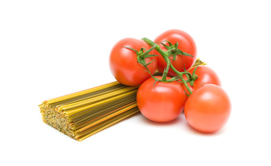 ripe tomatoes and spaghetti isolated on white background