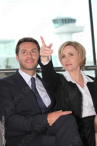 Businessman and woman pointing