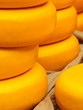 Piles of yellow Dutch cheese on a market