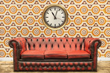 Retro styled image of a sofa and clock against a vintage wall