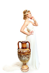 Beautiful young woman styled Greek with  amphora on white backgr