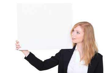 Woman in a suit with a board left blank for your message