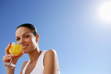 Woman enjoying fruit juice outdoors