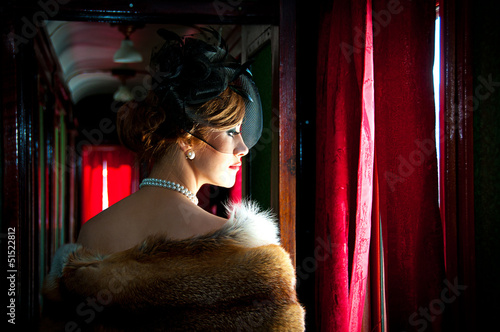 Retro Woman in hat with veil and fox furs