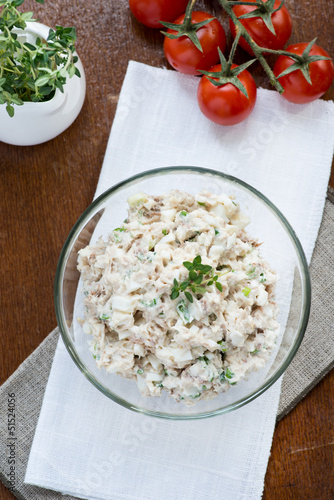 Smoked mackerel pate with eggs and herbs in glass bowl