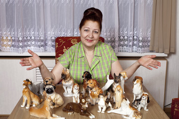Elderly woman with a collection of porcelain figurines of dogs