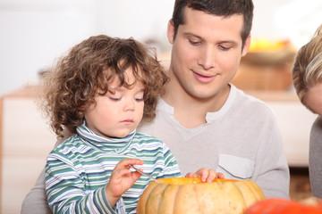child emptying pumpkin