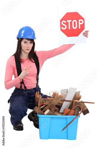 craftswoman holding a stop sign