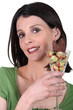 woman holding a glass with Easter chocolate  eggs