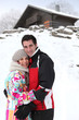 portrait of young couple at ski resort