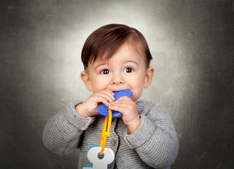 Little Boy Playing With Toy Key