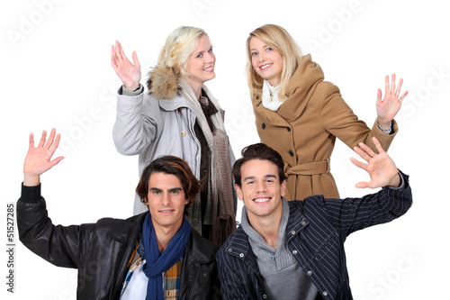 two young couples posing together