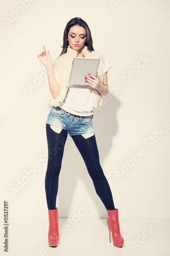 Attractive fashionable woman using digital tablet