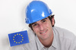 Smiling laborer with European flag