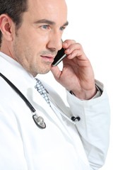 Doctor on phone smiling