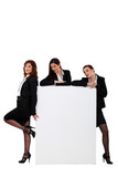 Three businesswomen with blank poster