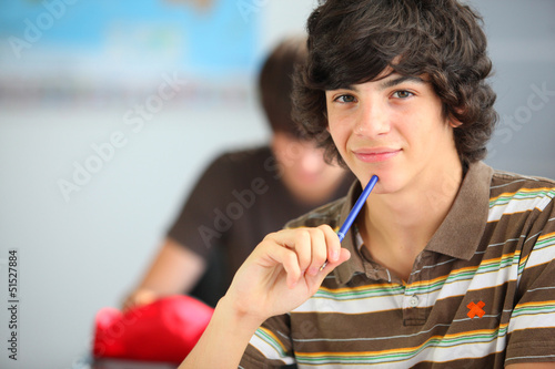 A teenage boy in the classroom
