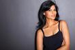 attractive latin fashion woman on black wall